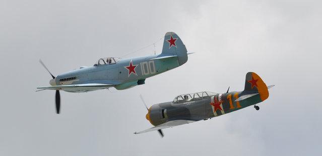 """Yakovlev Yak-3M """"White 100"""" G-CGXG and Yakovlev Yak 3U – Flying Legends Airshow Duxford 2012. (Rob Lovesey)"""