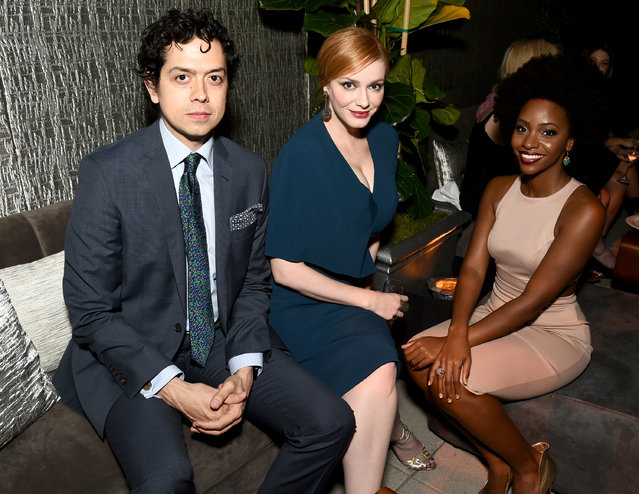 Geoffrey Arend, from left, Christina Hendricks, and Teyonah Parris attend the Television Academy's 67th Emmy Awards Performers Nominee Reception at the Pacific Design Center on Saturday, September 19, 2015, in West Hollywood, Calif. (Photo by Charles Sykes/Invision for the Television Academy/AP Images)