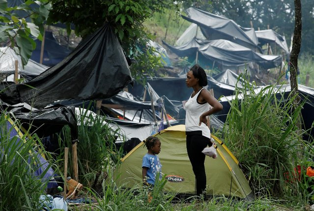 An African migrant stranded in Costa Rica stands with her child at a makeshift camp at the border between Costa Rica and Nicaragua, in Penas Blancas, Costa Rica, September 7, 2016. (Photo by Juan Carlos Ulate/Reuters)