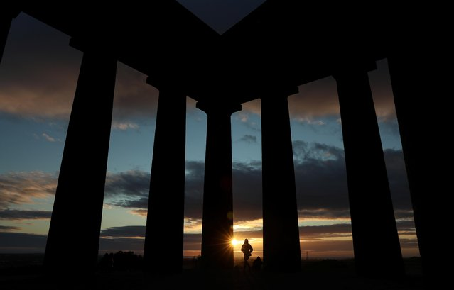 People watch the sunrise from Penshaw Monument, County Durham, Britain on July 29, 2020. (Photo by Lee Smith/Reuters)