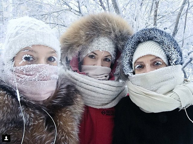 In this photo taken on Sunday, January 14, 2018, Anastasia Gruzdeva, left, poses for selfie with her friends as the temperature dropped to about –50 degrees (–58 degrees Fahrenheit) in Yakutsk, Russia. Temperatures in the remote, diamond-rich Russian region of Yakutia have dropped to near-record lows, plunging to –67 degrees Centigrade (-88.6 degrees Fahrenheit) in some areas. (Photo by Sakhalife.ru Photo via AP Photo)