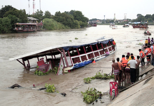 Thai rescue teams search for victims after a boat capsized at Chao Phraya River in Ayuthaya Province, Thailand, Sunday, September 18, 2016. Thai news reports say at least 13 people were killed when a double-decker passenger boat carrying more than 100 people capsized in the Chao Phraya River north of Bangkok. Some people were still missing after the accident, which occurred when the boat was involved in a collision Sunday afternoon, but it was not immediately clear how many. (Photo by Dailynews via AP Photo)
