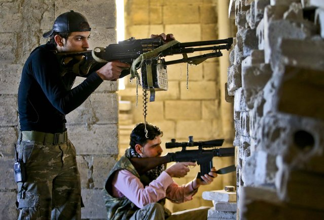 Free Syrian Army fighters, take their positions at the front lines of fighting in Syria, February 26, 2013. Rebels battled government troops near a landmark 12th century mosque in the northern city of Aleppo. (Photo by Hussein Malla/Associated Press)