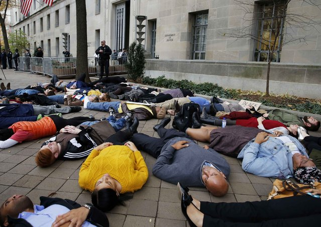 "Protestors stage a ""die-in"" as they rally against the Ferguson, Mo. Grand Jury exoneration of police officer Darren Wilson for his August 2014 shooting and killing of Michael Brown while, at the U.S. Justice Department in Washington, December 1, 2014. (Photo by Larry Downing/Reuters)"