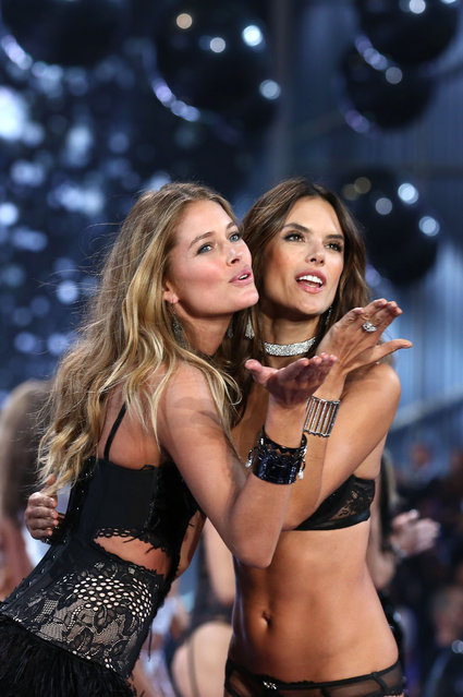 Alessandra Ambrosio (R) walks the runway at the annual Victoria's Secret fashion show at Earls Court on December 2, 2014 in London, England. (Photo by Tim P. Whitby/Getty Images)