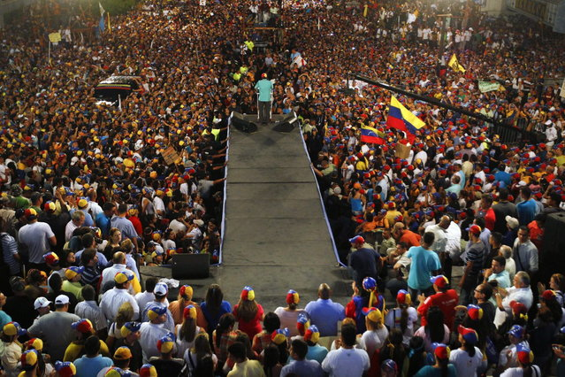 Venezuela's opposition leader and presidential candidate Henrique Capriles (C) speaks to supporters during a campaign rally in the state of Zulia April 10, 2013. (Photo by Carlos Garcia Rawlins/Reuters)