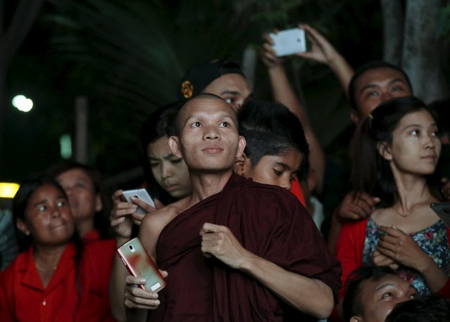 A monk observes election results outside the National League for Democracy (NLD) office in Mandalay, Myanmar, November 8, 2015. Voting began on Sunday in Myanmar's first free nationwide election in 25 years, the Southeast Asian nation's biggest stride yet in a journey to democracy from dictatorship. (Photo by Olivia Harris/Reuters)