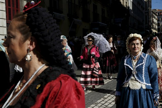 People dressed in traditional attire take part in a procession to celebrate Madrid's patron saint La Almudena Virgin in Madrid, Spain, November 9, 2015. (Photo by Susana Vera/Reuters)