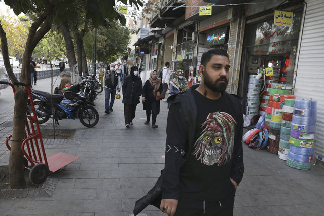 People walk around Tehran's Grand Bazaar, Iran, Sunday, November 8, 2020. Iranians welcomed the election of Joe Biden as the 46th President of the United States as a beacon of hope for the future of their country already battered by the most severe sanctions in its history. (Photo by Vahid Salemi/AP Photo)