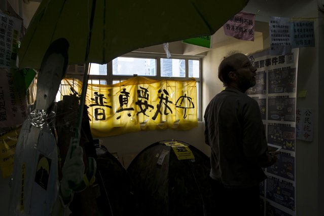 "A protest banner reading ""I want real universal suffrage"" collect from Occupy zone hangs on the window at a guesthouse in Hong Kong December 30, 2014. (Photo by Tyrone Siu/Reuters)"