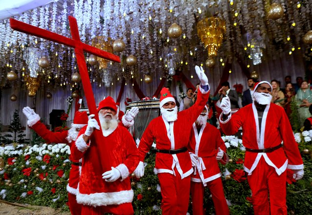 Pakistani Christians wear Santa Claus suits during a celebrations for Christmas, in Lahore, Pakistan, Wednesday, December 23, 2020. (Photo by K.M. Chaudary/AP Photo)