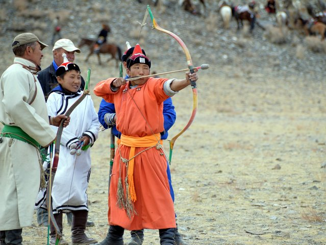 Archery contest in the games at the Eagle Hunting Festival in Ogliy, Mongolia. (Photo by Brad Ruoho/The Star Tribune)