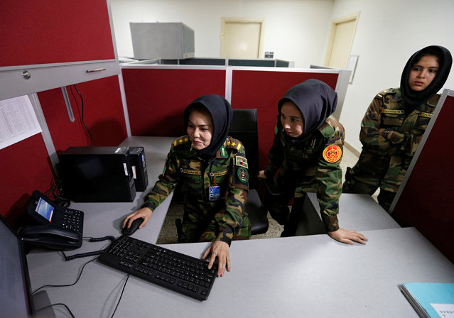 Second Lieutenant Roshan Gul, 22 (L), First Lieutenant Nelofar Frotan, 23 (C), and Second Lieutenant Morsal Afshar, 22 (R), work at the human resources office in the Ministry of Defence in Kabul, Afghanistan October 31, 2016. (Photo by Mohammad Ismail/Reuters)