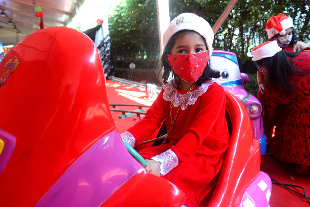 Children wearing Santa Claus hats play during a Christmas Day party amid the Covid-19 Coronavirus pandemic in the capital Dhaka, Bangladesh, on December 25, 2020. (Photo by Mamunur Rashid/NurPhoto via Getty Images)