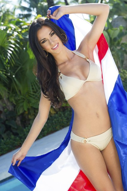 Miss Costa Rica 2014 Karina Ramos poses with her country's flag in swimwear at the 63rd Annual Miss Universe Pageant in Miami, Florida in this January 7, 2015, handout photo. (Photo by Reuters/Miss Universe Organization)