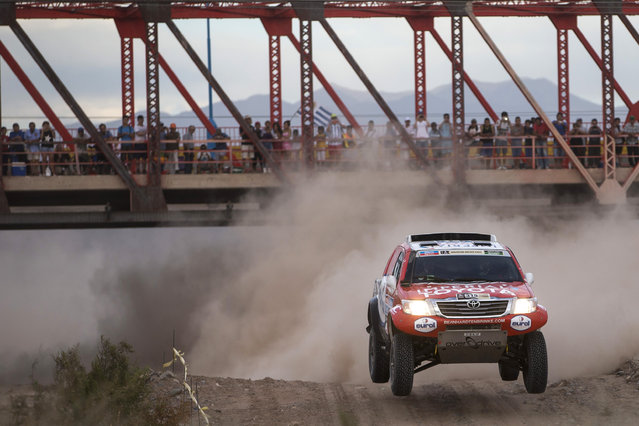 Toyota driver Bernhard Ten Brinke of Netherlands and co-pilot Tom Colsoul of Beligum race during the third stage of the Dakar Rally 2015 between the cities of San Juan and Chilecito, Argentina, Tuesday, January 6, 2015. The race will finish on Jan. 17, passing through Bolivia and Chile and returning to Argentina. (Photo by Felipe Dana/AP Photo)