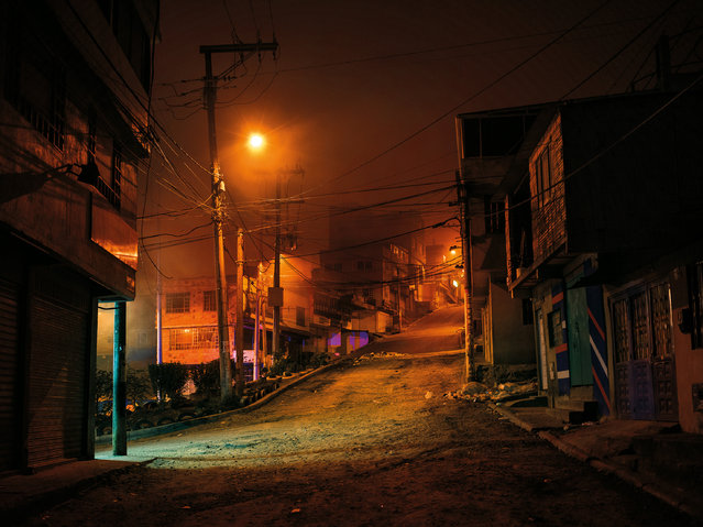Soacha, South of Bogotá at night. (Photo by Mads Nissen/Politiken/The Guardian/Panos Pictures)
