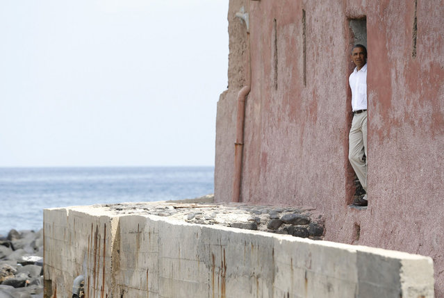 """U.S. President Barack Obama is pictured at the """"door of no return"""" as he visits the Maison Des Ecslaves, the gathering point where African slaves were shipped west until the mid-19th century, at Goree Island near Dakar, Senegal, June 27, 2013. (Photo by Jason Reed/Reuters)"""