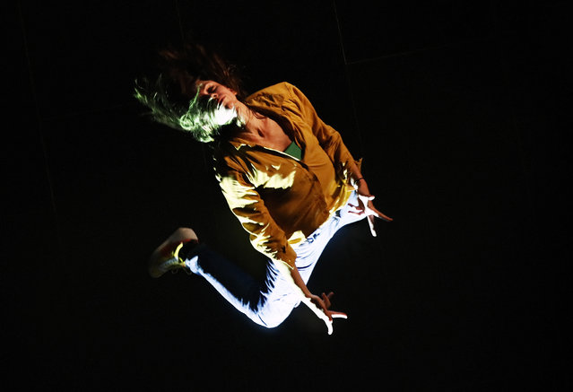 """Romanian modern dance artist Smaranda Gabudeanu performs, as seen from above the floor, during a multimedia-dance project entitled """"Alienation"""" inside the building of the Museum of Recent Art (MARe) in Bucharest, Romania, 05 November 2020. The performance """"Alienation or the desire for intimacy"""" is an international project realized through the collaboration between artists from Romania, Sweden and Northern Ireland, within the Durational Performance of Contemporary Dance. The multimedia performance, consisting of scenes inspired by the words alienation, desire and intimacy, was produced by PETEC ( a Romanian contemporary art platform) in partnership with Lava-Dansproduktion, being co-financed by the Administration of the National Cultural Fund of Romania and Konstnarsnamnden (The Swedish Arts Grants Committee). The official premiere will take place online, on Sunday 08 November 2020. (Photo by Robert Ghement/EPA/EFE)"""