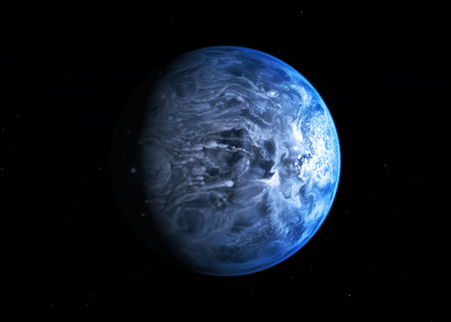 An artist's impression has been revealed today by NASA of the exoplanet HD 189733b. Like Earth, it is deep blue in colour, but its atmosphere is scorching with a temperature of over 1000 degrees Celsius, and it rains glass, sideways, in howling 7000 kilometre-per-hour winds, according to scientists. (Photo by NASA/ESA)