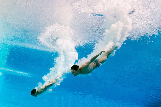 In a picture taken with an underwater camera Macau's Ng Wai Hou and Leong Kam Cheong compete in the men's 3-metre synchro springboard preliminary diving event in the FINA World Championships at the Piscina Municipal de Montjuic in Barcelona on July 23, 2013. (Photo by Francois Xavier Marit/AFP Photo)