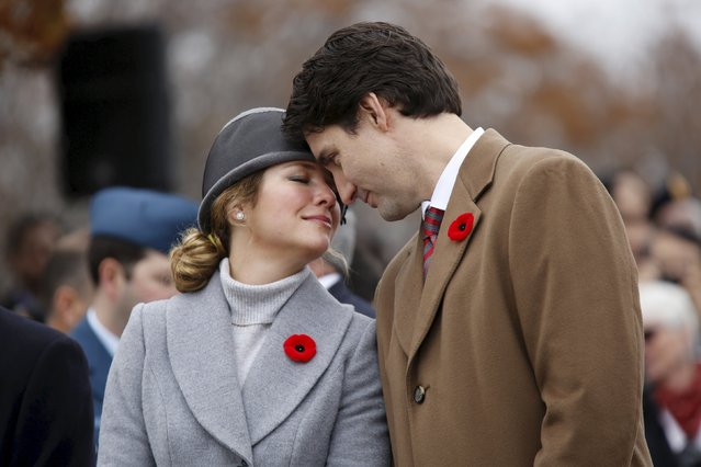 Canada's Prime Minister Justin Trudeau and his wife Sophie share a moment during Remembrance Day ceremonies at the National War Memorial in Ottawa, Canada November 11, 2015. (Photo by Chris Wattie/Reuters)