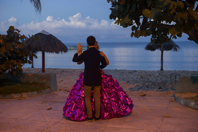 In this December 13, 2015 photo, Amanda Teresa Betancur, 15, who lives in Cuba, practices her opening dance with her boyfriend Erick before her quinceanera party in Havana, Cuba. (Photo by Ramon Espinosa/AP Photo)