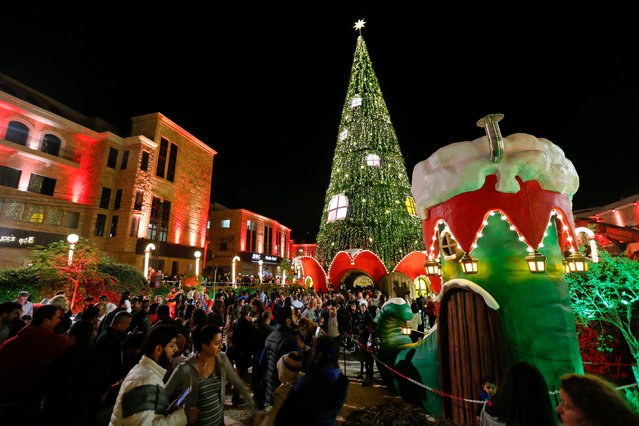 People gather around an illuminated Christmas tree in Byblos city in northern Lebanon November 24, 2016. (Photo by Jamal Saidi/Reuters)