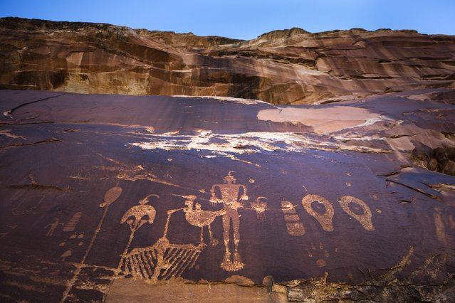 The 1000-year-old Wolfman Petroglyph Panel adorns a rockface within the proposed Bear Ears National Monument near Bluff, Utah, USA, 14 November 2016. (Photo by Jim Lo Scalzo/EPA)