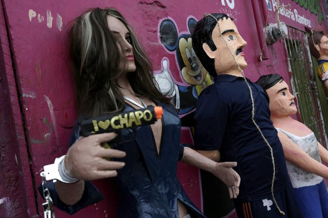 "Pinatas depicting Mexican actress Kate del Castillo (L) and the drug lord Joaquin ""El Chapo"" Guzman are displayed outside a workshop in Reynosa, in Tamaulipas state, Mexico, January 13, 2016. (Photo by Daniel Becerril/Reuters)"
