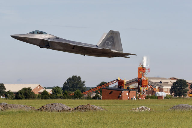 An F-22 departs Langley Air Force Base, Va., Tuesday morning, September 11, 2018, as Hurricane Florence approaches the Eastern Seaboard. Officials from Joint Base Langley-Eustis in Hampton said the base's F-22 Raptors and T-38 Talon training jets, as a precaution, were headed for Rickenbacker Air National Guard Base in central Ohio. (Photo by Jonathon Gruenke/The Daily Press via AP Photo)