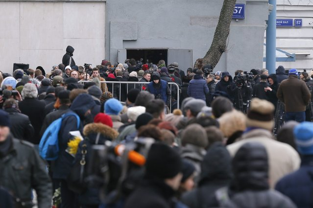 People arrive to attend a memorial service before the funeral of Russian leading opposition figure Boris Nemtsov in Moscow, March 3, 2015. Nemtsov's girlfriend has broken her public silence on the murder of the Russian opposition activist, saying she did not see the killer who gunned him down as they strolled across a bridge near the Kremlin. Anna Duritskaya, who is 23 or 24, said she had been under constant guard since the murder and would probably be unable to attend Nemtsov's funeral on Tuesday. REUTERS/Maxim Shemetov