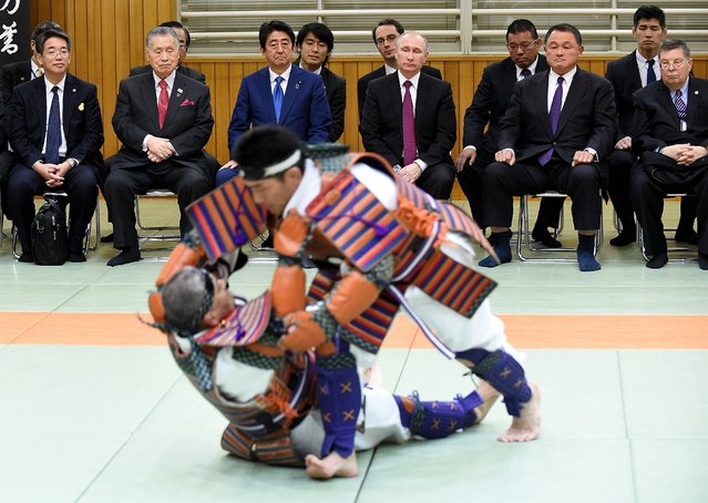 Russian President Vladimir Putin (3rd R), Japanese Prime Minister Shinzo Abe (3rd L), former Japanese Prime Minister Yoshiro Mori (2nd L) and vice chairman of the All Japan Judo Federation Yasuhiro Yamashita (2nd R) watch a demonstration of ancient custom judo during a visit to the Kodokan judo hall in Tokyo on December 16, 2016. Putin is on a two-day official visit to Japan. (Photo by Toru Yamanaka/AFP Photo)