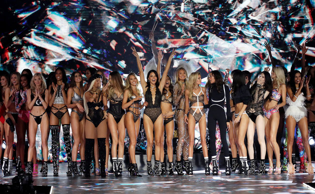 Models appear together on the runway at the conclusion of the 2018 Victoria's Secret Fashion Show in New York City, New York, U.S., November 8, 2018. (Photo by Mike Segar/Reuters)