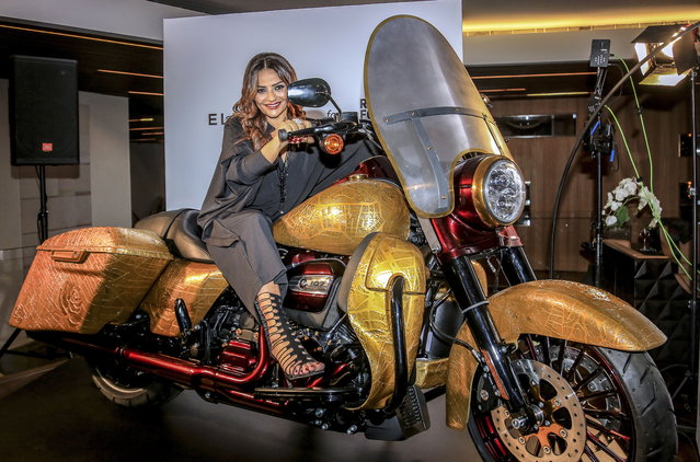 "Lebanese Souha Bsatt poses on her Harley-Davidson motorcycle custom designed by Lebanese fashion designer Elie Saab, during an auction dubbed ""Art Saves Lives"" at the Yacht Club Beirut, in Beirut, Lebanon 18 November 2018. The auction was organized by the non-government organization (NGO) ""Roads for Life"" on the occasion of the International Day of Remembrance for Victims of Road Accidents. Sixteen helmets designed by various Lebanese artists where put up on sale for the auction. (Photo by Nabil Mounzer/EPA/EFE)"