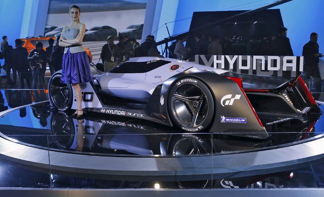 """A model poses next to Hyundai sports concept car """"Muroc"""" at the Indian Auto Expo in Greater Noida, on the outskirts of New Delhi, India, February 3, 2016. (Photo by Anindito Mukherjee/Reuters)"""