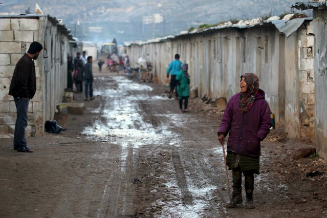 An internally displaced girl stands inside a refugee camp in Salkeen, Northern Idlib countryside, Syria, January 17, 2016. (Photo by Ammar Abdullah/Reuters)