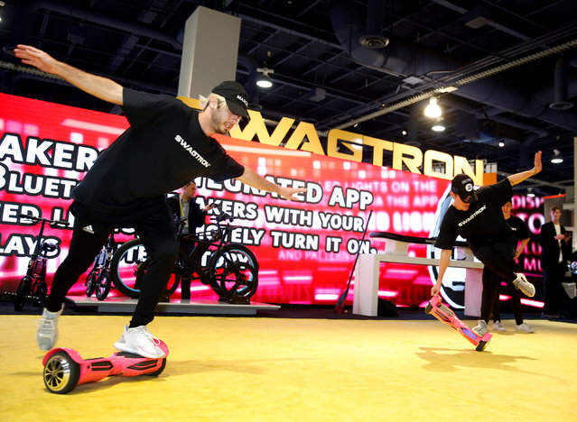 """""""Bot Broz"""" hoverboard dancers Damien Lavergne (L) and Alex Ditommaso perform on Swagtron hoverboards during the 2017 CES in Las Vegas, Nevada, January 6, 2017. (Photo by Steve Marcus/Reuters)"""