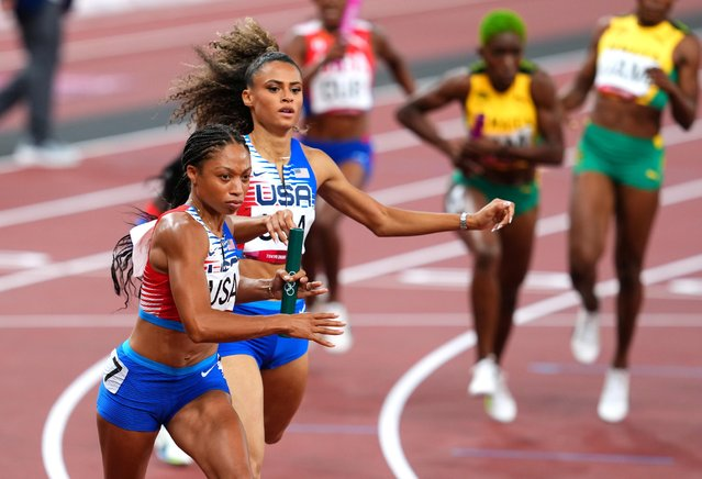 Allyson Felix of the United States receives the baton during the women's 4x400m relay final during the Tokyo 2020 Olympic Games at the Olympic Stadium in Tokyo on August 7, 2021. (Photo by Aleksandra Szmigiel/Reuters)