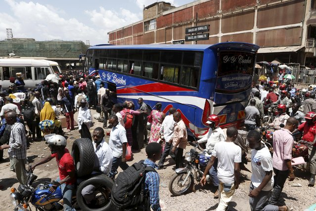 People board buses in Uganda's capital Kampala February 17, 2016, a day ahead of the presidential election. (Photo by James Akena/Reuters)