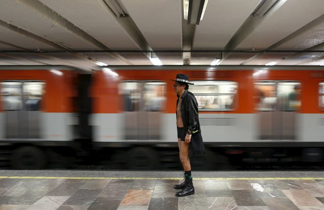 """A passenger not wearing pants waits for a subway train during the """"No Pants Subway Ride"""" in Mexico City, Mexico, February 21, 2016. (Photo by Carlos Jasso/Reuters)"""
