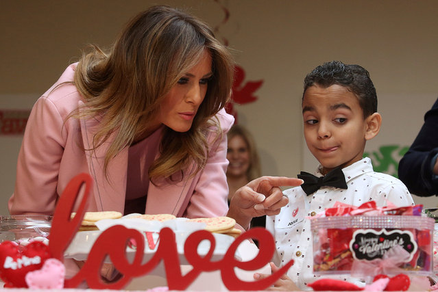 U.S. first lady Melania Trump talks with 9-year-old Josue (R) from Puerto Rico as she talks with children during a Valentine's Day visit with young patients at the Children's Inn at the National Institutes of Health (NIH) in Bethesda, Maryland, U.S., February 14, 2019. (Photo by Jonathan Ernst/Reuters)