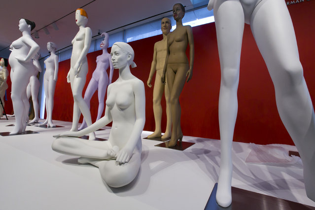 Mannequins are positioned during the installation of The Art of the Mannequin, by artist Ralph Pucci, at the Museum of Arts and Design, in New York on Thursday, March 26, 2015. (Photo by Richard Drew/AP Photo)