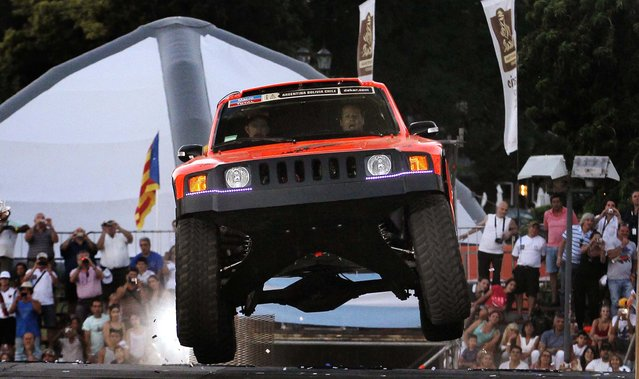 Robby Gordon and Kellon Walch of the U.S. power their Hummer from the podium during the departure ceremony of the sixth South American edition of the Dakar Rally on January 4, 2014. (Photo by Enrique Marcarian/Reuters)