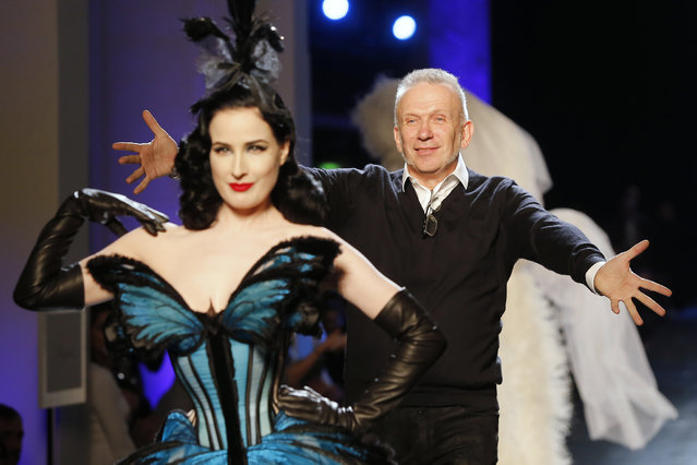 French fashion designer Jean-Paul Gaultier, right, rushes towards burlesque artist Dita Von Teese at the end of his Spring-Summer 2014 Haute Couture fashion collection, presented Wednesday, January 22, 2014 in Paris. (Photo by Jacques Brinon/AP Photo)