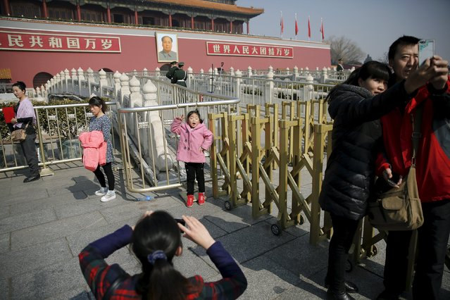 People have their pictures taken in front of Tiananmen Gate as the area near the Great Hall of the People prepares for upcoming annual sessions of the National People's Congress (NPC) and Chinese People's Political Consultative Conference (CPPCC), in Beijing March 2, 2016. (Photo by Damir Sagolj/Reuters)