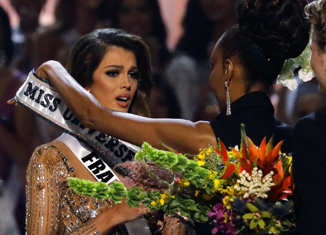 Miss France Iris Mittenaere reacts as the Miss Universe sash is put on her at the 65th Miss Universe beauty pageant at the Mall of Asia Arena, in Pasay, Metro Manila, Philippines January 30, 2017. (Photo by Erik De Castro/Reuters)