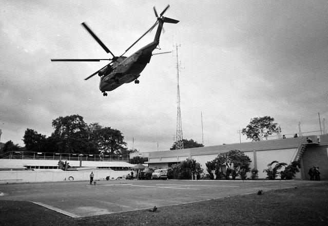In this April 29, 1975 file photo, a helicopter lifts off from the U.S. embassy in Saigon, Vietnam during last minute evacuation of authorized personnel and civilians. (Photo by AP Photo)