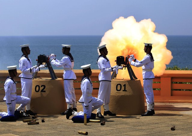 Sri Lanka's navy fires a gun salute as a part of main celebrations for Sri Lanka's 66th Independence Day in Colombo February 4, 2014. (Photo by Dinuka Liyanawatte/Reuters)