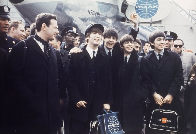 The Beatles leave London Airport, 1964.  From left: manager Brian Epstein, John Lennon, Paul McCartney, Ringo Starr and George Harrison. (Photo by AP Photo)